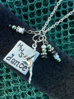 "$15 - A silver-colored square polymer clay charm stamped with ""HHS dance"" attached to a tibetan silver ballet dancer charm. Adorned with beads and hangs from an 18 inch silver plated chain."