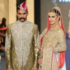 Models present creations by designer Nomi Ansari during the Pakistan Fashion Design Council (PFDC) Bridal Week in Lahore on October 12, 2013.