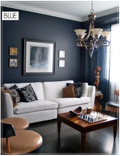 Blue walls, white couch