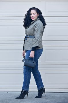 Girl With Curves blogger Tanesha Awasthi wears a belted utility jacket.