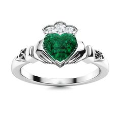 Enchanted fantasy meets exotic wonder in the Ovemia, a beautiful combination of fantastic elements. The heart of this Emerald ring in 14k White Gold is literally the glittering heart-shaped gemstone at its center, held in a bezel setting and complemented by detailed hand designs featuring Celtic embellishments. The heart is crowned by four more gemstones, the perfect touch to bring about a fairy-tale romance to this inspired masterpiece. Natural Emerald Rings, May Birthday, Love Ring, The Perfect Touch, Hand Designs, Shades Of Green, Vintage Rings, Enchanted, Celtic