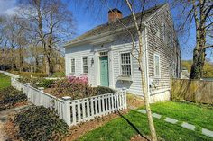 Cape Cod cottage, small but sometimes the smaller houses are the ones that feel most at home
