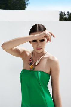 #SphereMagazine has just launcheded Vol.6 No.2 and this amazing fashion shoot from Ibiza is featured inside. This green satin dress is by Safiyaa and the Chunky metal and multi-coloured stone necklace is by Mawi.  Read More at http://www.spherelife.com/  #Fashion #travel #magazine
