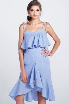 Eva Check Ruffle Sleeveless Top Discover the latest fashion trends online at storets.com #tops #sleevelesstops #checkruffletops #fashion #ootd #storetsonme