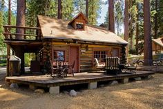 This is a tiny log cabin near Lake Tahoe. From the outside, you'll notice log siding and a gable roof with a fun second story balcony off one side of the home. When you go inside, you'l… Prefab Cabin Kits, Small Log Cabin Plans, Modular Log Cabin, Cabin Plans With Loft, Little Log Cabin, Tiny Log Cabins, Log Cabin Floor Plans, Cabin House Plans, Log Cabin Homes