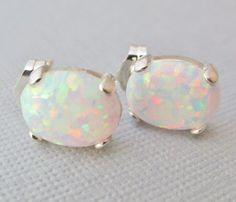 Hey, I found this really awesome Etsy listing at https://www.etsy.com/listing/211308386/white-opal-earrings-sterling-silver-opal