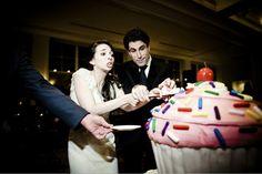 funny photo by Viera Photographics of cake cutting at wedding reception   via junebugweddings.com