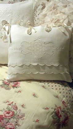 Vintage linen pillow cover. I've sewn in ribbon at the top and tied the bows.