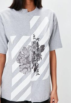 Splice up your life in this graphic tee - featuring a light grey hue, floral embroidered detailing and raw edge hem. It's the perfect piece for throw-on-and-go style.