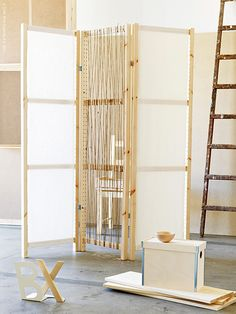 DIY Divider made with Ivar shelving components and Ditte and Aina Fabric.