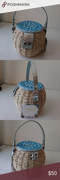 Cappelli round straw bag Cappelli small round straw bag with silver hardware and handle.  Turn key lock closure. Beautiful blue and white stones on top of bag.  Inside has zipper pocket.  Has original tags.  Hand made natural materials. Capelli of New York Bags Mini Bags