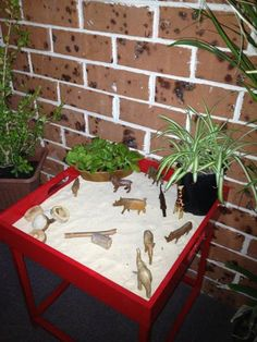"A tray table used for small play at Puzzles Family Day Care ("",)"