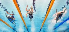 Katie Ledecky (C) competes in the women's 400-meter freestyle heats at the 16th FINA World Championships at the Kazan Arena on Aug. 2, 2015 in Kazan, Russia