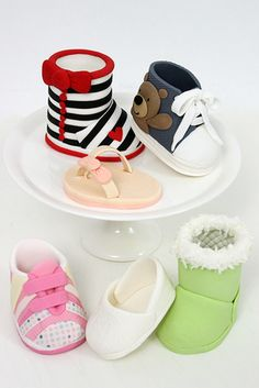 Baby shoes cake toppers - by Sharon Wee Creations. Tutorials available for purchase Fondant Figures, Fondant Cakes, Cupcake Cakes, Fondant Toppers, Cupcake Toppers, Cake Topper Tutorial, Fondant Tutorial, Cake Decorating Techniques, Cake Decorating Tutorials