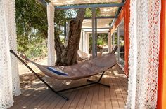 Hammock on deck of shipping container home.