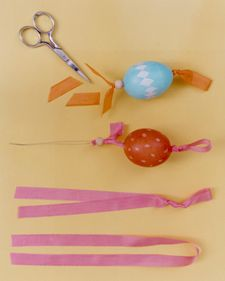 Martha Stewart on how to attach strings to eggs so they can hang on an Easter egg tree.