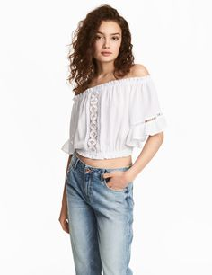 Check this out! Short, off-the-shoulder top in woven, crinkled viscose fabric with lace inserts and short dolman sleeves with ruffle trim. Elastication and gathers at upper edge and at hem. - Visit hm.com to see more.