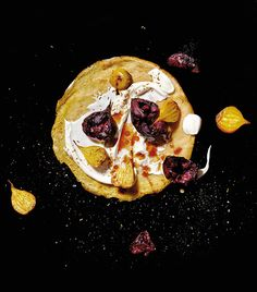 For these chickpea crepes with roasted beet and yogurt: place a few roasted beets on the crepe, add a couple of tablespoons of labneh or plain Greek yogurt, a drizzle of pomegranate molasses, and a sprinkle of toasted cumin seed salt, then roll up and eat. Roll and serve.