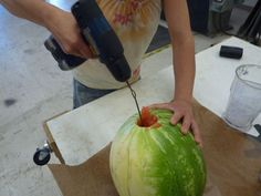 Make watermelon juice with a drill and a coat hanger (Just don't tell your picnic guests how you did it...)