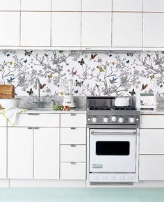 Using wallpaper as a kitchen backsplash is cheap and easy to DIY!