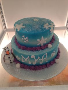 Frozen cake with Olaf. Buttercream icing airbrushed