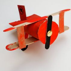 Transform cardboard, popsicle sticks, and a toilet roll into a cute biplane airplane!  Fun craft for kids!