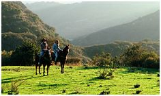 Horseback riding at Circle Bar B Ranch. 1.5 hours for $50, 1/2 day (4 hrs) for $0, and private rides (1.5 hr, 2.5 hr, 1/2 day). Ranch located a few miles north of Refugio State Beach.