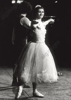 akg-images -The two Italian ballet dancers Carla Fracci and Amedeo Amodio in a scene of 'The Fairy's Kiss' by Stravinsky, at the Teatro Comunale di Bologna. Bologna, winter 1971.