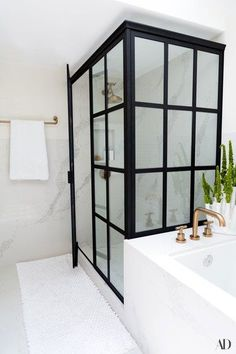 """""""I was always quite clear about what I wanted,"""" says fashion stylist and television host Louise Roe of her Los Angeles master bathroom renovation. """"I wanted a beautiful, clean marble or quartz. We ended up doing quartz, which has a great vein going through it but nothing so dramatic that it detracts from the accessories in the room.""""   archdigest.com"""