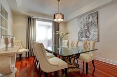 Principle art can add personality and brighten a dining room. 2331 North Ridge Trail, Oakville