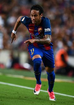 Neymar Jr. of FC Barcelona runs with the ball during the La Liga match between Barcelona and Eibar at Camp Nou on 21 May, 2017 in Barcelona, Catalonia.