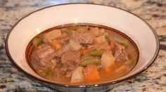 Slow Cooker BEST-EVER Beef Stew - True comfort food!  www.GetCrocked.com
