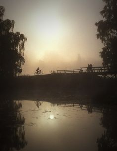 Early, cold, morning in September, a cyclist on her way to work over the wooden bridge from Borgmästarholmen.