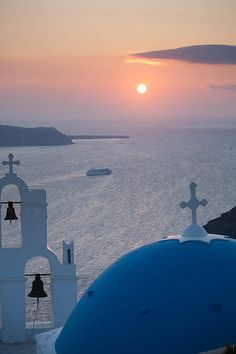Watch the sunset from Oia, Santorini, Greece