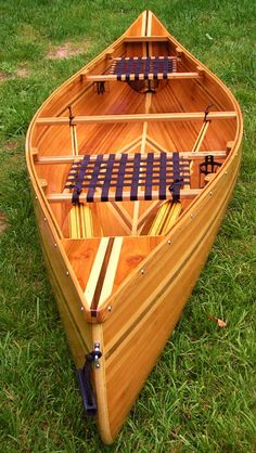 Custom cedar canoe with black walnut & ash accents and seats. Has a set of paddles to match. About 12ft long and 3ft wide, very stable.