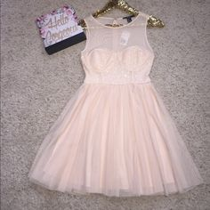 Forever 21 party dress This dress is champagne color has tulle and a sheer top and slight padding. zipper back also has a lining in the skirt. New with tags beautiful dress. Forever 21 Dresses