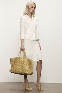 A lovely version of the cabat bag a long with a feminine suit from Bottega Venetas resort collection of 2013