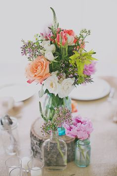 pretty floral centre pieces - Read more on One Fab Day: http://onefabday.com/jacquelyne-mae-photography-taylor-lucas/