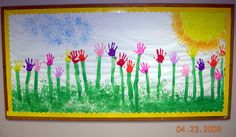 I love the bright and colorful student hand print flowers in this spring bulletin board display.