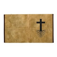 """Jesus Deep Root Cross        Designed for Apple's iPad 1, iPad 2, and new iPad (iPad 3).      Water-resistant fabric wrapped hardcover exterior with elastic strap closure.      Suede interior with document pocket and elastic device corners straps.      Rubberized edges create folded viewing stand.      Handmade with recycled materials in Brooklyn, New York.      Size 9.87"""" x 8""""."""