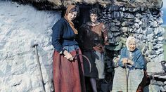 Three generations of peasant women stand outside their stone cottage.These remarkable photographs were taken by Clifton R. Adams in the 1920s. Adams captured the idyllic nature of Ireland and rural life in the early 20th century.