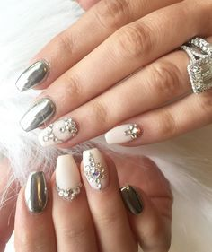 Here we see a combination of metallic colors and matte nails with rhinestones. Matte nails are perfectly served to minimize big gloss of metallic color and zircons.