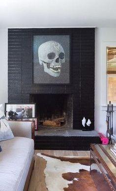 Black brick wall fireplace #skull