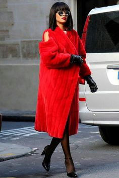 Red coat with shoulder cut outs.