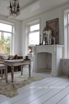 Ons huis | Servies & Brocante  I like this although I don't decorate in all white.  Like the layered mantel.