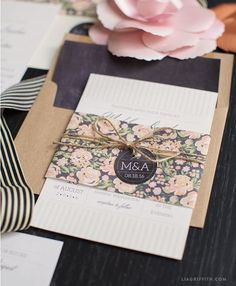 Find our full vintage wedding invitation suite for your dream vintage wedding. These invites feature a natural white seersucker stripe with watercolor roses