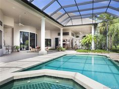 pool and spa under screened lanai.  Grey Oaks in Naples, FL