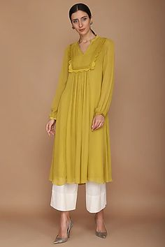 VARUN BAHL Featuring a mustard green kurta in viscose georgette base with cupro satin frills. It is paired with contrasting khada pajama pants in cotton flex base. Neck Designs For Suits, Dress Neck Designs, Blouse Designs, Pakistani Fashion Casual, Abaya Fashion, Fashion Dresses, Pakistani Suits, Indian Fashion, Women's Fashion