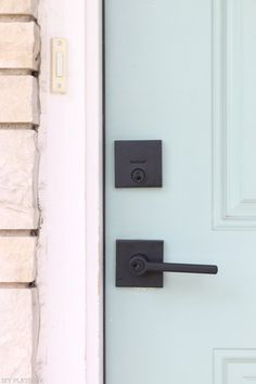 Sleek black doorknob that is safe and stylish! From DIY Playbook using Kwikset Downtown Low Profile Deadbolt and Halifax Lever