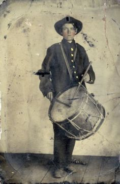 Post Mortem Drummer boy. Held up by stand - No, just a healthy good looking drummer boy!